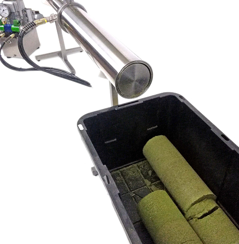 Iron-Fist-Colum-Packer-Unloading-Cannabis-Material-for-extracting